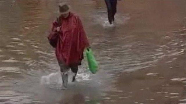 Woman walking in flooded streets