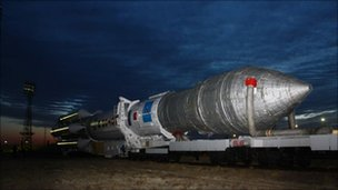 Russian Proton-M rocket carrying the three Glonass satellites is carried to the launch pad - 2 December 2010