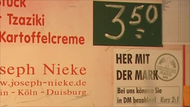 Sign on German market stall saying Deutsche marks are accepted