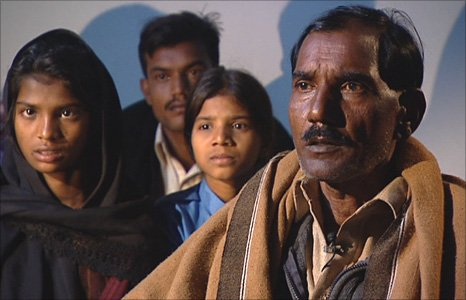 Ashif Masih, right, husband of Christian woman Asia Bibi who had been sentenced to death, and daughters Shahzadi (left) and Sidra (middle)