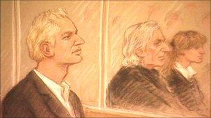 Julian Assange (left) in court