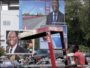 Election posters of Ivory Coast President Laurent Gbagbo and of former prime minister and presidential candidate of the Rally of the Republicans (RDR) Alassane Outtara in Abidjan