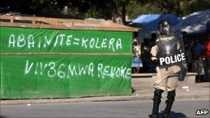 Haitian police patrol a street during a protest against the UN on November 19, 2010 in Port-au-Prince.