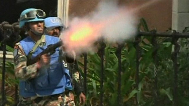 UN soldier fires tear gas
