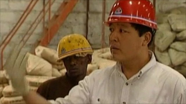 Chinese foreman working on African construction site