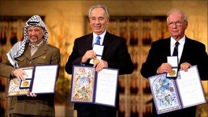 Yasser Arafat, Shimon Peres, Yitzhak Rabin with their Nobel Prize for peace, Oslo, Dec 1994