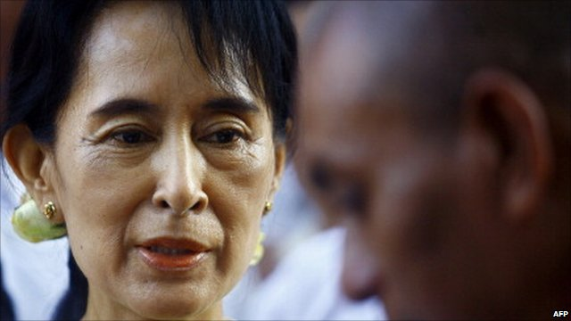 Burma's Aung San Suu Kyi greets a monk in December 2010 soon after her release from house arrest