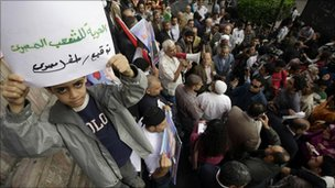 "A boy holds a sign reading ""Freedom to Egyptian people"" at a protest in Cairo, 4 December"