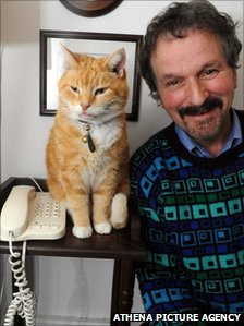 Howard Moss with his cat Ginger