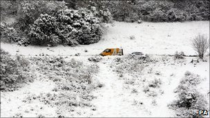 A recovery van attends to a vehicle near Boxhill in Surrey