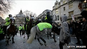 Mounted officers are used to police protest