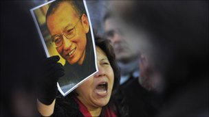 A protester holds an image of jailed dissident Liu Xiaobo outside of the Chinese Embassy in Oslo December 9, 2010