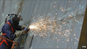 Builder works on the one of the two new aircraft carriers due to enter service in 2020
