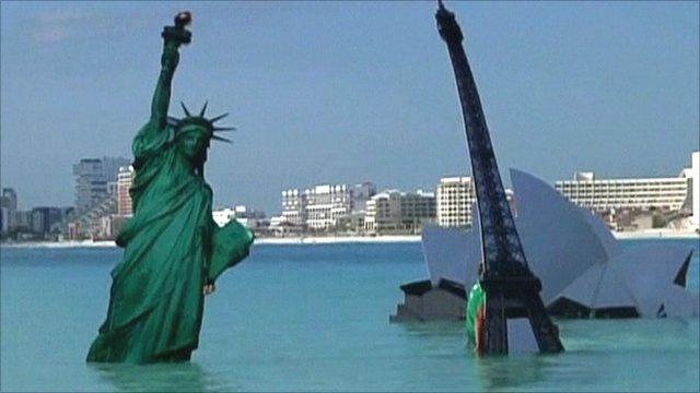 World landmarks symbolically drowning at global warming protest