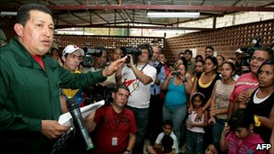 President Hugo Chavez addressing flood victims in Caracas