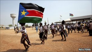 Southern Sudanese rally behind their flag in support of independence