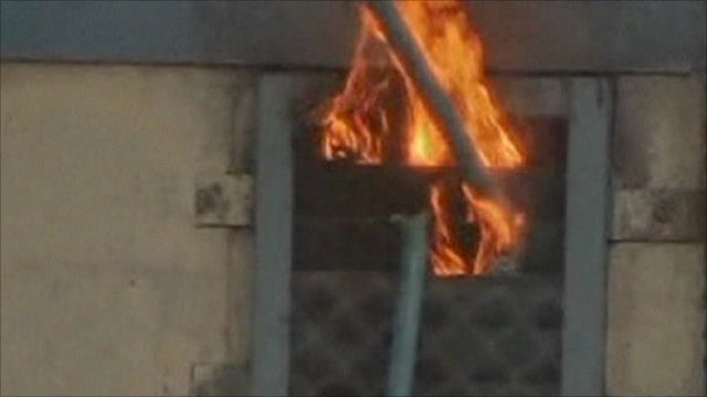 Fire comes from the window of one of the cells