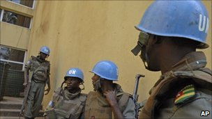 UN soldiers guard the headquarters of Alassane Ouattara in Abidjan, 10 December