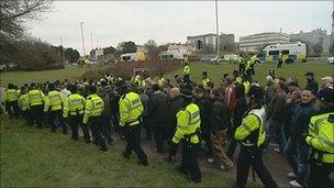 Police escort football fans