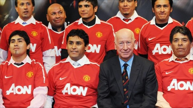 Sir Bobby Charlton in a photo-call with some of the Chile miners
