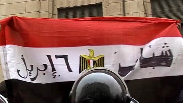 Flag held up during protest in Cairo