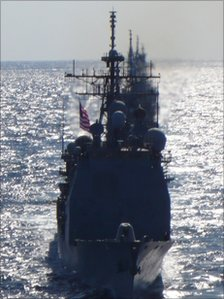 Several warships travelling in a flotilla with the USS George Washington
