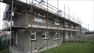Homes with scaffolding outside