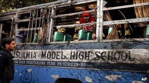 The damaged school bus in Peshawar on 13 December 2010