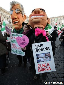 Anti-government demonstrators in Rome, with figures of Silvio Berlusconi and Umberto Bossi (Northern League leader), 11 December 2010