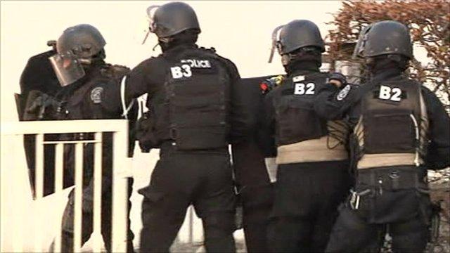 Police prepare to surround the building