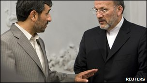 Iran's President Mahmoud Ahmadinejad (L) & former Foreign Minister Manouchehr Mottaki