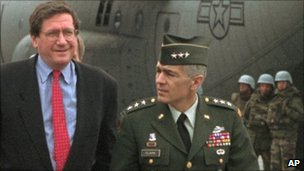 Richard Holbrooke (left) is escorted by US Gen Wesley Clark after arriving at Sarajevo airport, 29 September 1995