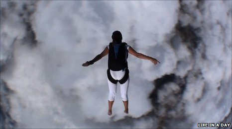 An American female bare foot free-falling sky diver in Kevin Macdonald's Life In A Day