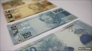 A photo illustration of new Brazilian R$50 and R$100 real currency notes after their launch in Brasilia on 13 December 2010