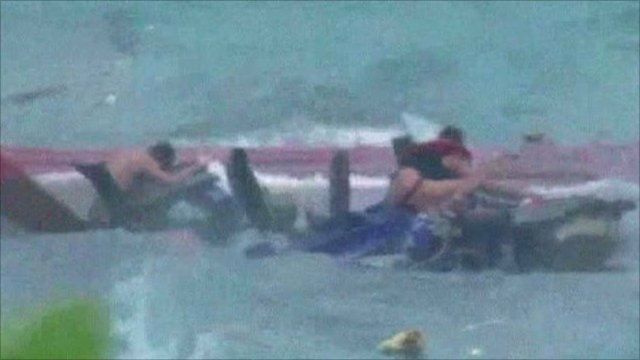 Survivor clings to wreckage