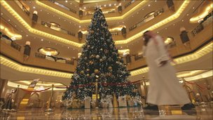 A jewel-encrusted Christmas tree adorns the lobby of the Emirates Palace hotel in Abu Dhabi, the UAE