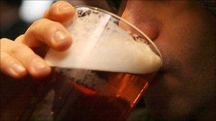 Man drinking a pint