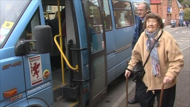 Ruth Lawless with an Accessible Transport West Somerset bus