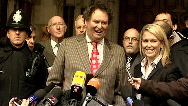 Julian Assange's lawyer Mark Stephens (centre)