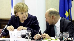 German Chancellor Angela Merkel talks to Romanian President Traian Basescu, 16 Dec 10