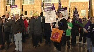 Union members outside the hospital with placards