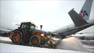 Snow ploughs clear the taxi ways at Heathrow Airport after heavy snowfall