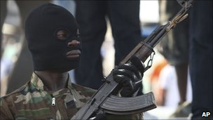 A soldier stands guard during a youth rally in Abidjan (18 December)