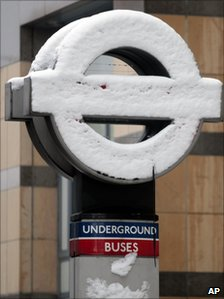 A London Underground sign covered in snow