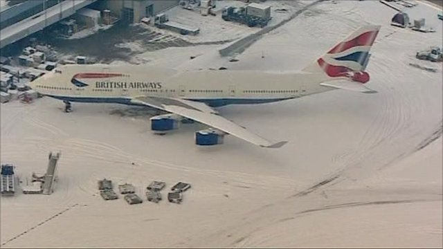 Snow covered plane at Heathrow
