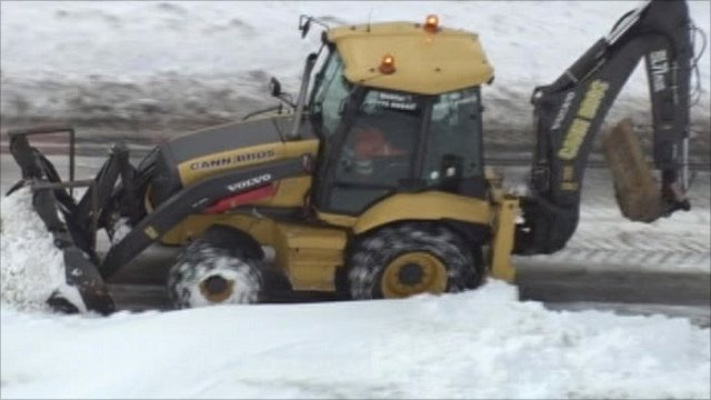 Tractor helping to clear snow