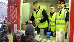 Luke Cozens (centre) serves tea with fellow Salvation Army volunteers