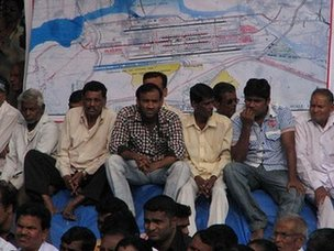 Villagers listen to speeches of politicians about the new airport