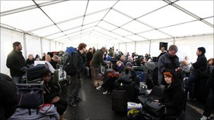 Passengers waiting in a marquee outside Heathrow Terminal 3
