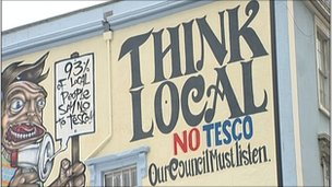 Sign painted on building in Stokes Croft